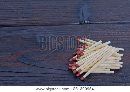 Matches With Brown Heads On A Table