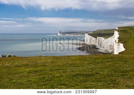 The Seven Sisters Chalk Cliffs Between Seaford And Eastbourne. East Sussex. England. Viewed From Hop