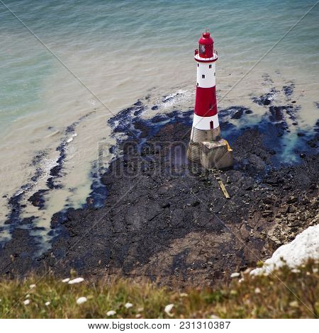 Beachy Head, Sussex, Uk - May 11 : The Lighthouse In Low Tide At Beachy Head In Sussex On May 11, 20