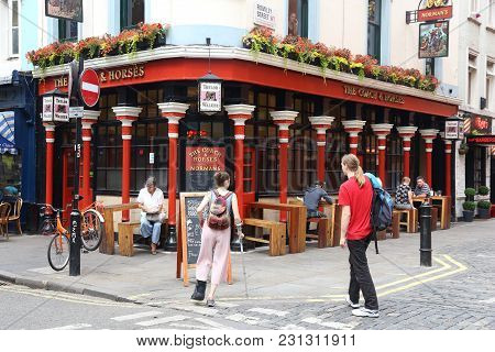 London, Uk - July 9, 2016: People Visit The Coach And Horses Pub In Soho, London. It Is A Typical Lo