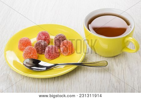 Red Marmalade And Teaspoon In Saucer, Cup Of Tea On Wooden Table