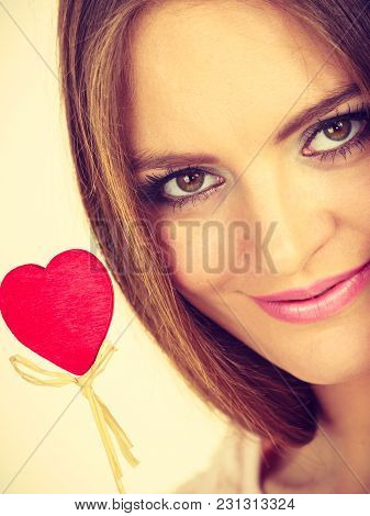 Romantic Gestures, Valentines Gifts Ideas Concept. Happy Flirty Woman Holding Red Wooden Heart On St