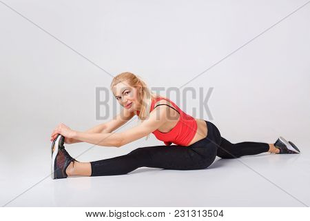 Beautiful Sporty Woman In Sportswear Doing Twine. Stretching