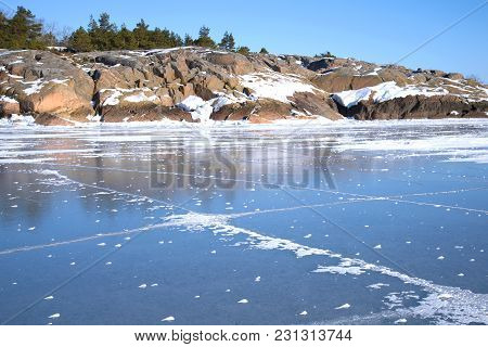 Rocky Coast Of Hanko And Ice Of The Gulf Of Finland On A Sunny February Day. Finland