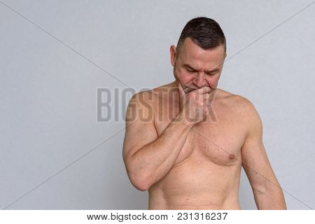 Portrait Of Naked Mature Man Looking Concerned