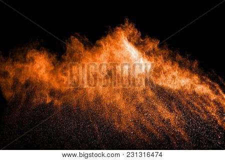 Abstract Gold Dust Explosion On  Black Background.abstract Gold Powder Splatter On Black Background,