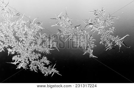Black And White Drawings On The Glass In The Frost .