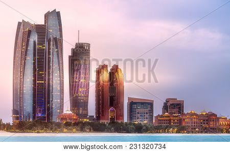 Abu Dhabi, Uae - April 01, 2016: View Of Abu Dhabi Skyline, Etihad Towers And National Bank Of Abu D