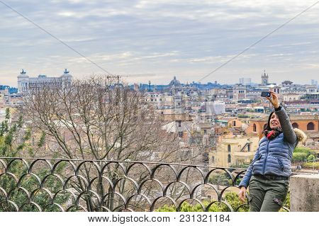 Rome, Italy, December - 2017 - Woman Taking A Selfie At Monte Pincio Viewpoint At Villa Borghese