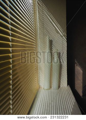 Golden Metal Blinds, In The White Aperture Of The Window There Are 2 Porcelain Vases, From The Blind