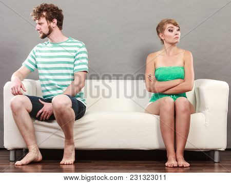 Bad Relationship Concept. Man And Woman In Disagreement. Young Couple After Quarrel Sitting Offended