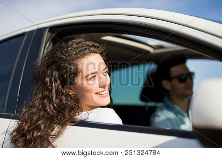 Awesome Young Woman Looking Outside From Car Window With Her Hair Flying In Wind. Woman Sitting In P