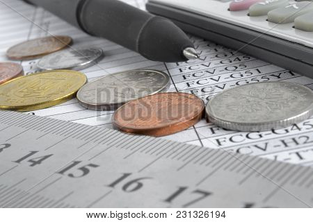 Financial Background With Different Coins, Ruler And Table.