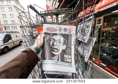 Paris, France - Mar 15, 2018: Man Buying French Liberation Newspaper With Portrait Of Stephen Hawkin
