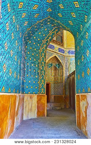 Isfahan, Iran - October 20, 2017: The Bright Blue Corridor Of Chaharbagh Madraseh Leads To The Summe