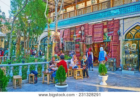 Isfahan, Iran - October 20, 2017: The Small Outdoor Cafe In Courtyard Of Grand Bazaar Is Neighboring