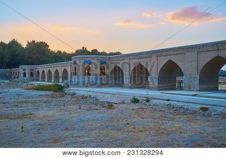 The Sunset Over Medieval Joui Bridge Over The Dried-up Zayandeh River, Isfahan, Iran.