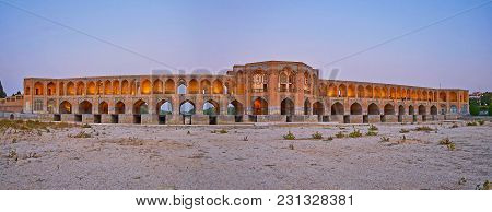 Evening Panorama Of Safavid Era Khaju Bridge, Decorated With Numerous Arches, Tiled Patterns And Pai
