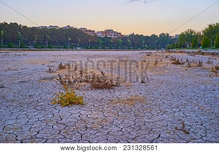 The Sunset Sky Over The Dried-up Zayandeh River With Cracked Mud On Its Bottom And Beautiful Riversi