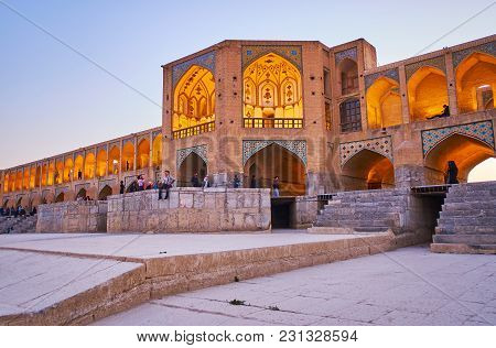 Isfahan, Iran - October 20, 2017: The  Khaju Bridge Is Popular Tourist Place, People Relax On Terrac