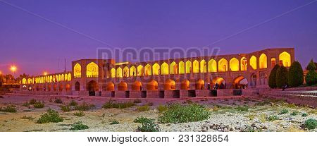 Evening Panorama From The Dried Up Bottom Of Zayanderud River  - Arched Brick Khaju Bridge In Bright