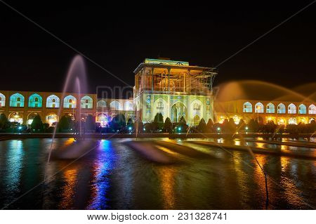Isfahan, Iran - October 20, 2017: The Evening View Of Qapu Palace, Located On Nagsh-e Jahan Square W