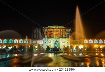 Isfahan, Iran - October 20, 2017: The View On Brightly Illuminated Qapu Palace Through The Beautiful