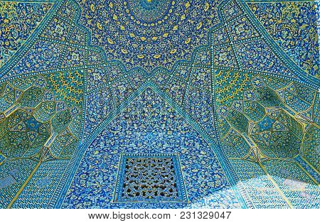 Isfahan, Iran - October 20, 2017: The Complex Vault Of Chaharbagh Madraseh With Rich Tiled Patterns,