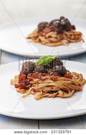 Spaghetti With Tomato Sauce And Meatballs On White