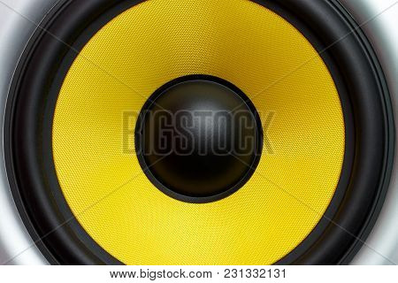 A Yellow Loudspeaker Close-up Of A Musical Column, A Symbol Of Music.