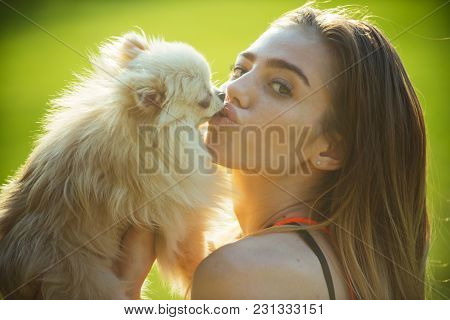 Woman Kiss Small Dog, Friend. Sensual Woman With Cute Spitz Puppy, Pet. Pet, Companion, Friend, Frie