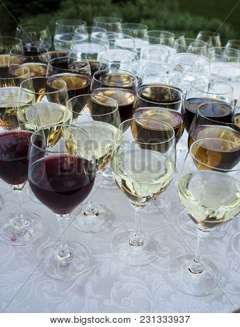A Lot Of Glasses With Wine On Holiday