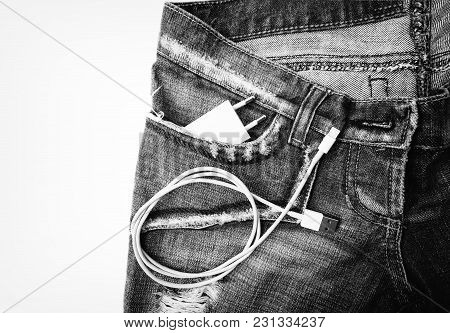 White Usb Cable In Jeans Pocket Usb Cord With The Jeans Pocket. Close-up