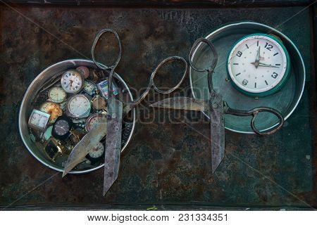 Unusual Art Still Life With Old Rusty Metal Black Scissors: The Tools Lie On Round Silver Dishes Fil