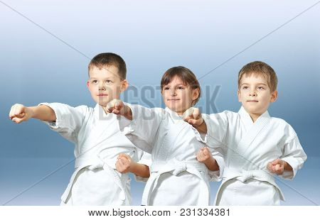Three Young Athlete Beat Punch Arm On The Light Background