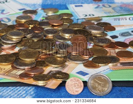 Euro Banknotes And Coins (eur), Currency Of European Union Selective Focus