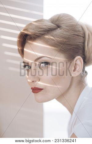 Womens Cunning And Tricks Concept. Woman With Cunning Face With Makeup On Light Background. Girl Wit