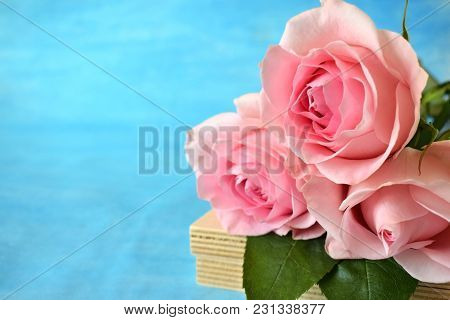 Bouquet Of Three Pink Roses On Blue Background. Copy Space