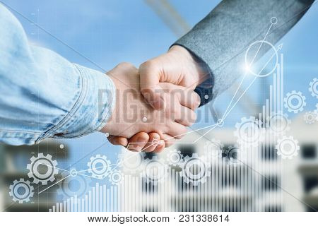 Handshake On The Background Of The Construction. The Concept Of The Success Of The Cooperation.