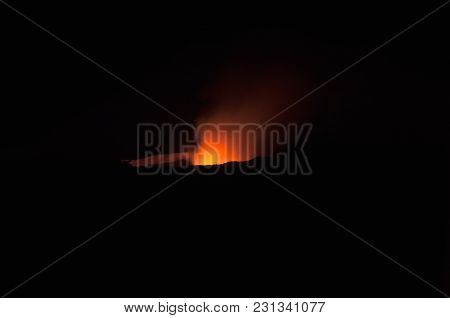 Crater Of The Ertha Volcano, Night Photography, The Muzzle Of The Fire On The Black Background, The