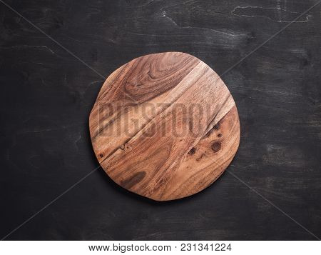 Round Wooden Tray Or Cutting Board On Black Table. Top View Of Empty Kitchen Trendy Rustic Wooden Tr