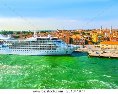 Venice, Italy - Cruise Ship Docked At The Port Of Venice, Italy On A Background Of The Roofs