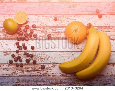 Tasty Fruit Platter On Vintage Wood Background