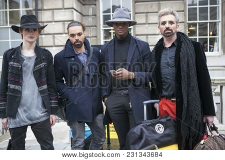 London - February 18: Company Of Men Models With Makeup  Poses For Photographers With Silver Rings