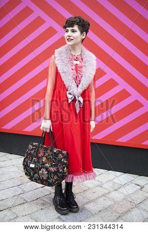 London - February 18: Stylish Woman In Red Dress With Furs Colar  Poses During London Fashion Week O