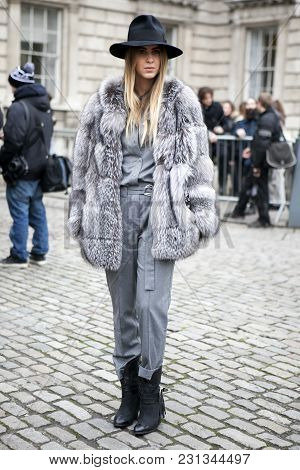 London - February 18: Blond Woman In Grey Fur Coat  Poses For Photographers With Silver Rings  Outsi