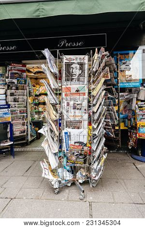 Paris, France - Mar 15, 2018: Vertical Photo International Newspapes Stack With Portrait Of Stephen
