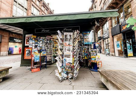Paris, France - Mar 15, 2018: International Newspapes Stack With Portrait Of Stephen Hawking The Eng