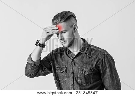 Conceptual Image Of Young Man Touching His Head With Hand While Isolated On White Background. Bearde