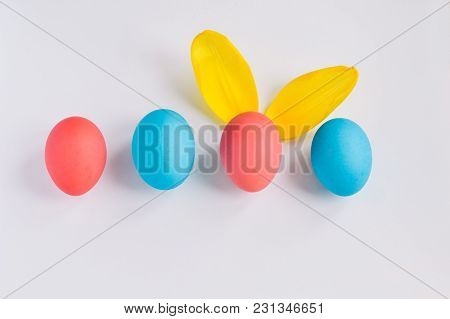 Happy Easter Concept. Big Colorful Eggs With Furry Bunny Ears Isolated On White Background